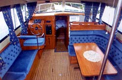 The saloon seating in this boat converts to a double bed